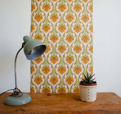 1970's french wallpaper with geometric flower design in greens, browns and orange, full roll